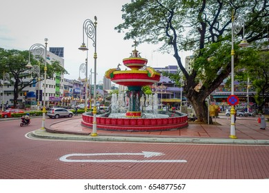 Kuala Lumpur, Malaysia - March 9, 2017: Ganesh elphant water fountain in Little India neighborhood, recently transformed into a wide street with Indian stores and restaurants.