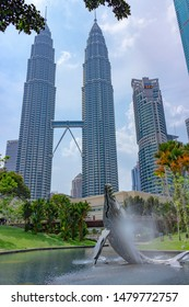 Kuala Lumpur, Malaysia - Mart 11, 2019: The beautiful view of KLCC park with whale water fountain and Petronas Twin Towers in sunny day