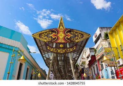 Kuala Lumpur, Malaysia - Mart 12,2019: Main entrance to the shopping street decoration a national symbol of the 'wau bulan' is type of Malay kite which looks like a butterfly. Hustle and bustle street