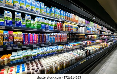 KUALA LUMPUR, MALAYSIA - MAY 04, 2020: Variety of milk and dairy products in bottles and box paper cartons on the shelves in a grocery store supermarket. Dairy beverages industry. Protein and calcium.
