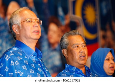 Kuala Lumpur, Malaysia - May 06, 2013: Malaysian Prime Minister Najib Abdul Razak (L) and ousted deputy Muhyiddin Yassin (R) sing the party's anthem after winning the 13th general elections.