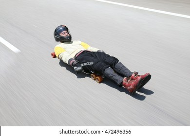 KUALA LUMPUR, MALAYSIA - MAY 07, 2016 : An unknown sportsman speeding on a street luge. Street luging is a form of extreme gravity powered sport.