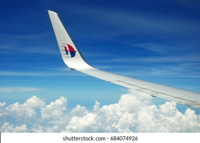 KUALA LUMPUR, MALAYSIA - MAY 09, 2015: Malaysia Airlines airplane wing with MAS logo on the sky. Malaysia Airlines behad is the flag carrier of Malaysia and a member of the oneworld airline alliance.
