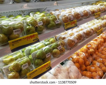 KUALA LUMPUR, MALAYSIA -MAY 10, 2018: Fruits packed in plastic wrapped and arranged on a supermarket rack.