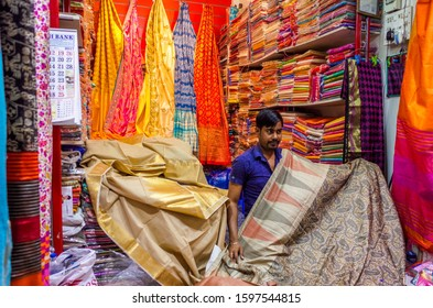 Kuala Lumpur, Malaysia, May 10th 2019. Beautiful, various materials are selling by Hindu people at a local market in capital city. Various design of batik painting displays in craft shop.