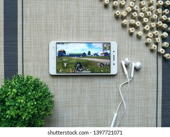 KUALA LUMPUR, MALAYSIA - MAY 14, 2019 : Smartphone with PUBG Mobile App. PUBG also known as PlayerUnknown's Battlegrounds is an online multiplayer battle royale game.
