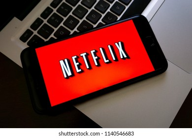 Kuala Lumpur, Malaysia - May 16, 2018:  Smartphone displaying Netflix word on laptop with selective focus and crop fragment