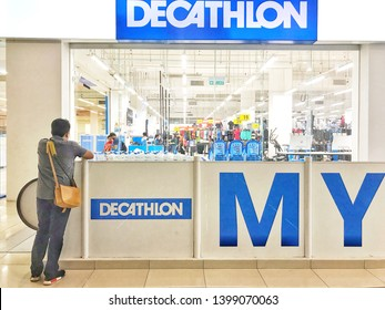 KUALA LUMPUR, Malaysia - May 16, 2019 : A man stands in front of a Decathlon shop in Kuala Lumpur, Malaysia. Decathlon is the largest sporting goods reseller, founded in 1976.