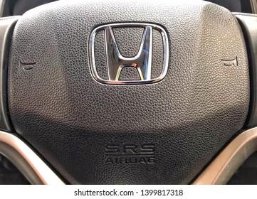 KUALA LUMPUR, Malaysia - MAY 17, 2019 : Honda logo on Honda Jazz car steering wheel.