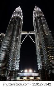 Kuala Lumpur, Malaysia - May 20, 2011: Low angle view of Petronas Twin Towers by night. Petronas Towers is one of the landmarks of Kuala Lumpur