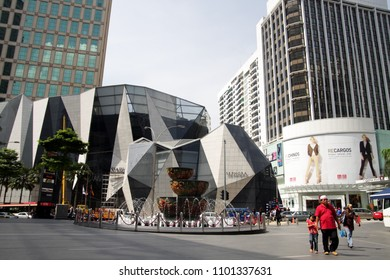 Kuala Lumpur, Malaysia - May 20, 2011: View of the Pavilion Crystal Fountain, Starhill Galery and Grand Millennium Kuala Lumpur Hotel in the Bukit Bintang district with people