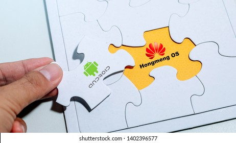Kuala Lumpur, Malaysia, May 20, 2019 : Image of white jigsaw puzzle showing current issue of Android OS being replaced by Hongmeng OS by Huawei containing both logo of company