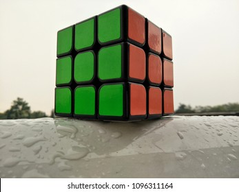 Kuala Lumpur , Malaysia - May 2018: Wet Rubik's cube on wet floor. Rubik's cube invented by a Hungarian architect Erno Rubik in 1974.
