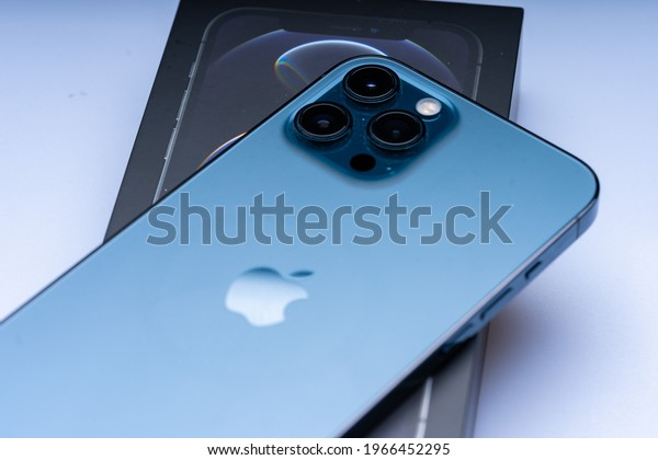 Kuala Lumpur, Malaysia - May 2021. The new iphone 12 pro max, pacific blue colour