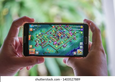 KUALA LUMPUR, MALAYSIA - MAY 21, 2019 : An Android user plays Clash of Clans, a free-to-play augmented reality mobile game developed by Supercell Ltd. for iOS and Android devices.