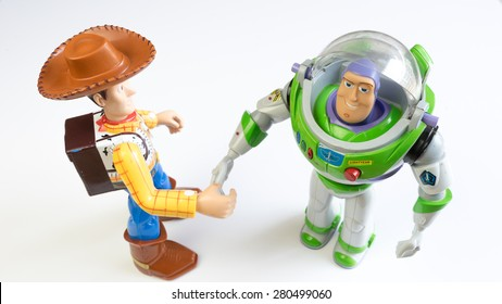 Kuala Lumpur, Malaysia - May 22, 2015: Sheriff Woody and Buzz Lightyear robot toy character from Toy Story. Toy Story is a computer-animated buddy-comedy adventure film by Pixar and Walt Disney