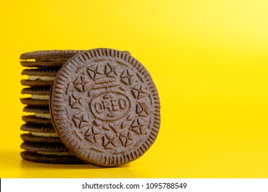 KUALA LUMPUR, Malaysia -May 22,2018: OREO cookies on yellow background. Oreo is a sandwich cookie with a sweet cream is the best selling cookie in the US.