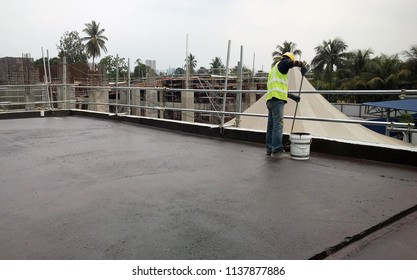 KUALA LUMPUR, MALAYSIA -MAY 25, 2018: Waterproofing layer applied by construction workers on concrete surface. Waterproofing layer to prevent water from entering below of the concrete slab.