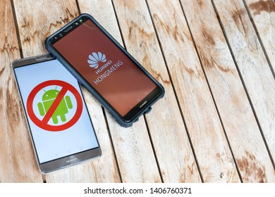 KUALA LUMPUR, MALAYSIA, MAY 25, 2019: Huawei phones with No Android signage,  and another with Hongmeng OS symbol. U.S. companies began  to curb sales to Chinese telecom Huawei