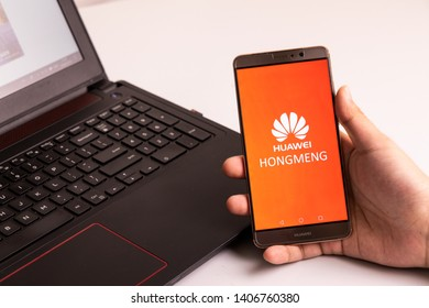 KUALA LUMPUR, MALAYSIA, MAY 25, 2019: Person holding Huawei Mate phone with Hongmeng OS symbol. U.S. companies began  to curb sales to Chinese telecom Huawei