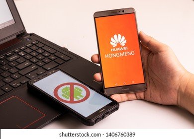 KUALA LUMPUR, MALAYSIA, MAY 25, 2019: Person holding Huawei phones with No Android signage,  and another with Hongmeng OS picture. U.S. companies began  to curb sales to Chinese telecom Huawei