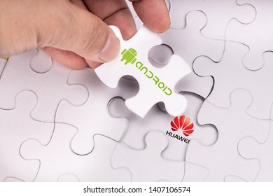 KUALA LUMPUR, MALAYSIA, MAY 25, 2019: Concept of hand removing Android OS from Huawei in jigsaw puzzle.   U.S. companies began  to curb sales to Chinese telecom Huawei