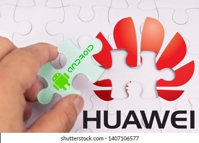 KUALA LUMPUR, MALAYSIA, MAY 25, 2019: Concept of hand removing Android OS from Huawei, in jigsaw puzzle.  U.S. companies began to curb sales to Chinese telecom Huawei
