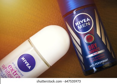 KUALA LUMPUR, MALAYSIA - MAY 25, 2017 : Nivea deodorant anti-perspirant over the wooden table, Light leak and selective focus.