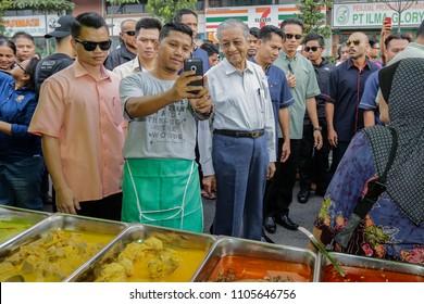 KUALA LUMPUR, MALAYSIA - MAY 27, 2018. The seventh Prime Minister of Malaysia, Mahathir Mohamad spend time visiting Ramadan bazaar at Jalan Raja Alang in Kuala Lumpur, Malaysia.