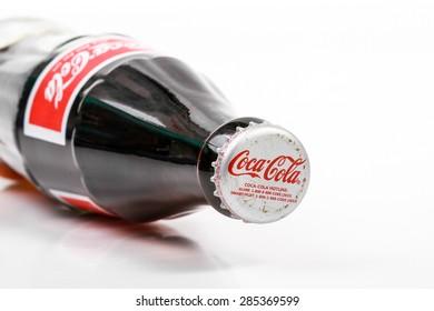 KUALA LUMPUR, MALAYSIA - MAY 28, 2015: Classic bottle Of Coca-Cola isolated on white studio shot.