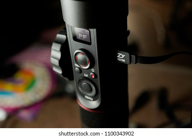 KUALA LUMPUR, MALAYSIA - MAY 28TH, 2018 : ZHIYUN Crane 2 - The Industry-First Camera Stabilizer Integrating Follow Focus and OLED Display. User is doing Device firmware updating
