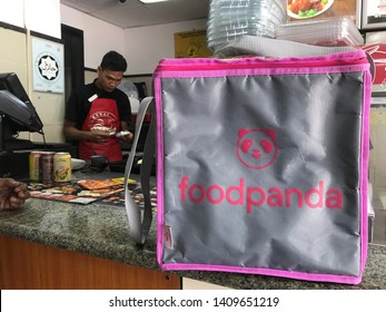Kuala Lumpur, Malaysia - May 28th, 2019 : Foodpanda backpack at local restaurant, ready to pickup the food. Foodpanda is food delivery service using apps in smartphone.