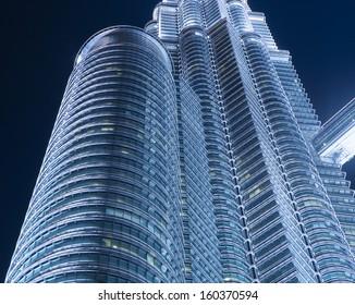 KUALA LUMPUR, MALAYSIA - MAY 3: Petronas Twin Towers exterior design on May 3, 2013 in Kuala Lumpur, Malaysia. These buildings are the most popular tourist attraction in Kuala Lumpur.
