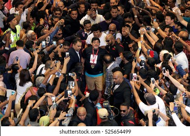 KUALA LUMPUR, MALAYSIA - MAY 30, 2015: Legendary Argentine's soccer player, Diego Maradona is greeted fans as he arrives for opening of jewelry shop in Kuala Lumpur, Malaysia.