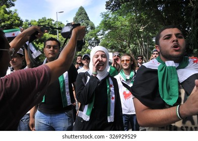 KUALA LUMPUR, MALAYSIA - MAY 31ST 2013: Unidentified Syrian and Malaysian people are marching and demonstrating against Bashar Assad in front of Syria Embassy in Kuala Lumpur, Malaysia.