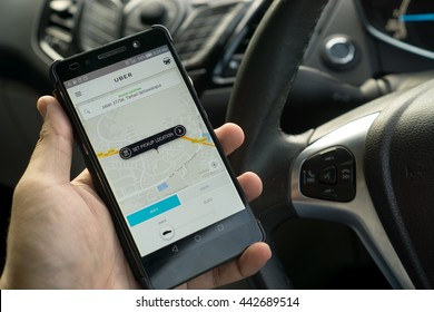 KUALA LUMPUR, MALAYSIA - MAY 31ST, 2016: modern lifestyle with smartphone to stay connected and browsing favourite Apps. Make your travel easy with UBER. Be a driver or a passenger.