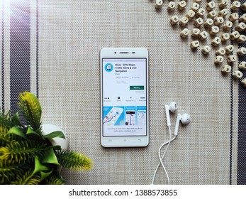 KUALA LUMPUR, MALAYSIA - MAY 5, 2019 : Install and stay connected to Waze App with smartphone. Waze App offer GPS, Maps, Traffic Alert and Live Navigation. - Image