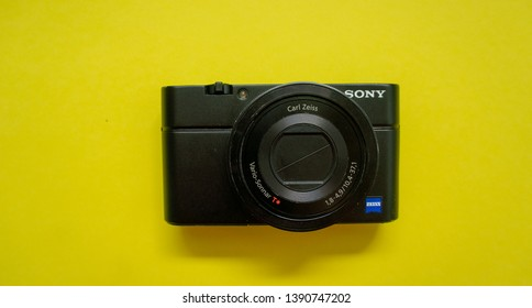 Kuala Lumpur, Malaysia - May 6, 2019 : studio shot of digital compact camera Sony RX100 on yellow background.One of the best high-end compact cameras