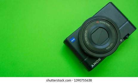 Kuala Lumpur, Malaysia - May 6, 2019 : studio shot of digital compact camera Sony RX100 on green background.One of the best high-end compact cameras