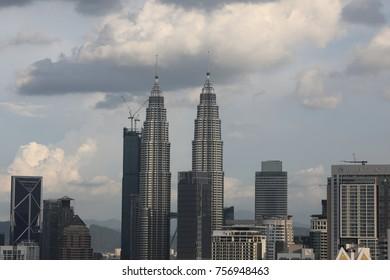 KUALA LUMPUR, MALAYSIA - NOV 12, 2017: Kuala Lumpur cityscape showing Petronas twin towers, also known as KLCC building during sunrise from the top of Regalia Residence Kuala Lumpur, Malaysia.