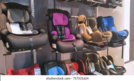 KUALA LUMPUR, MALAYSIA - NOV 17TH, 2017 : Various brand of child car seats in the shop. Child car seat is a seat designed specifically to protect children from injury or death during collisions.