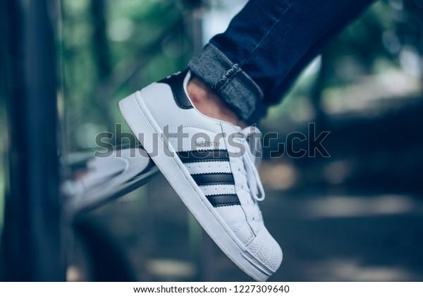 491e46a7 Kuala Lumpur, Malaysia - Nov 2018 : A girl wearing Adidas Superstar white  with black