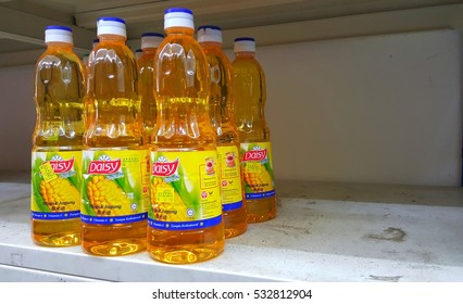 KUALA LUMPUR, MALAYSIA - NOV 28TH, 2016 :Close up image of Daisy corn oil bottles on the supermarket shelf.  Daisy Corn Oil is a highly stable cooking oil that is suitable for  cooking and baking.