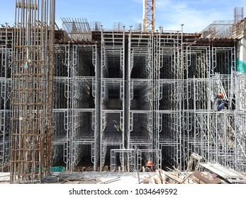 KUALA LUMPUR, MALAYSIA -NOVEMBER 10, 2017: Construction worker risk their life installing metal scaffolding at the construction site.