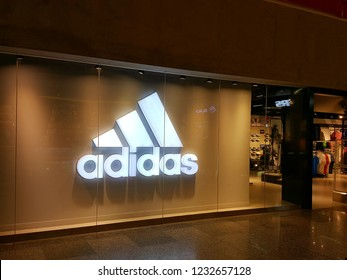 Kuala Lumpur / Malaysia - November 11 2018: Adidas store in shopping mall. Adidas AG is a multinational corporation, founded and headquartered in Herzogenaurach, Germany.