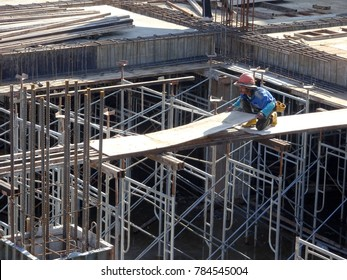 KUALA LUMPUR, MALAYSIA -NOVEMBER 11, 2017: Metal scaffolding used as temporary structure to support slab timber form work at the construction site. Able to adjust to get required level.