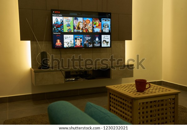 KUALA LUMPUR, MALAYSIA - November 11TH, 2018 : Modern lifestyle with Philiph Android TV to stay connected & browsing media using favourite Apps. Tv display netflix app with choices of movie