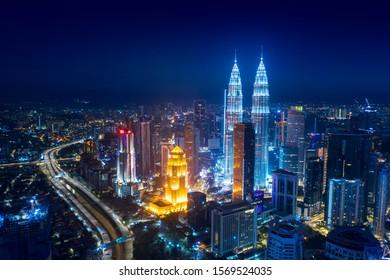 KUALA LUMPUR - Malaysia. November 12, 2019: Drone view of Kuala Lumpur city skyline with illuminated Petronas twin towers and near freeway shot at night