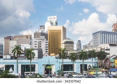 KUALA LUMPUR, MALAYSIA - NOVEMBER 14: The colonial architecture of the Central market contrast with modern bank office building. The city is an important islamic finance center.