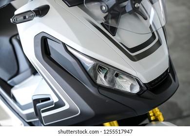 KUALA LUMPUR, MALAYSIA - NOVEMBER 15, 2018 : Front light. Detail and close up of Honda X-ADV 745cc Adventure Scooter / Crossover Adventure Bike.